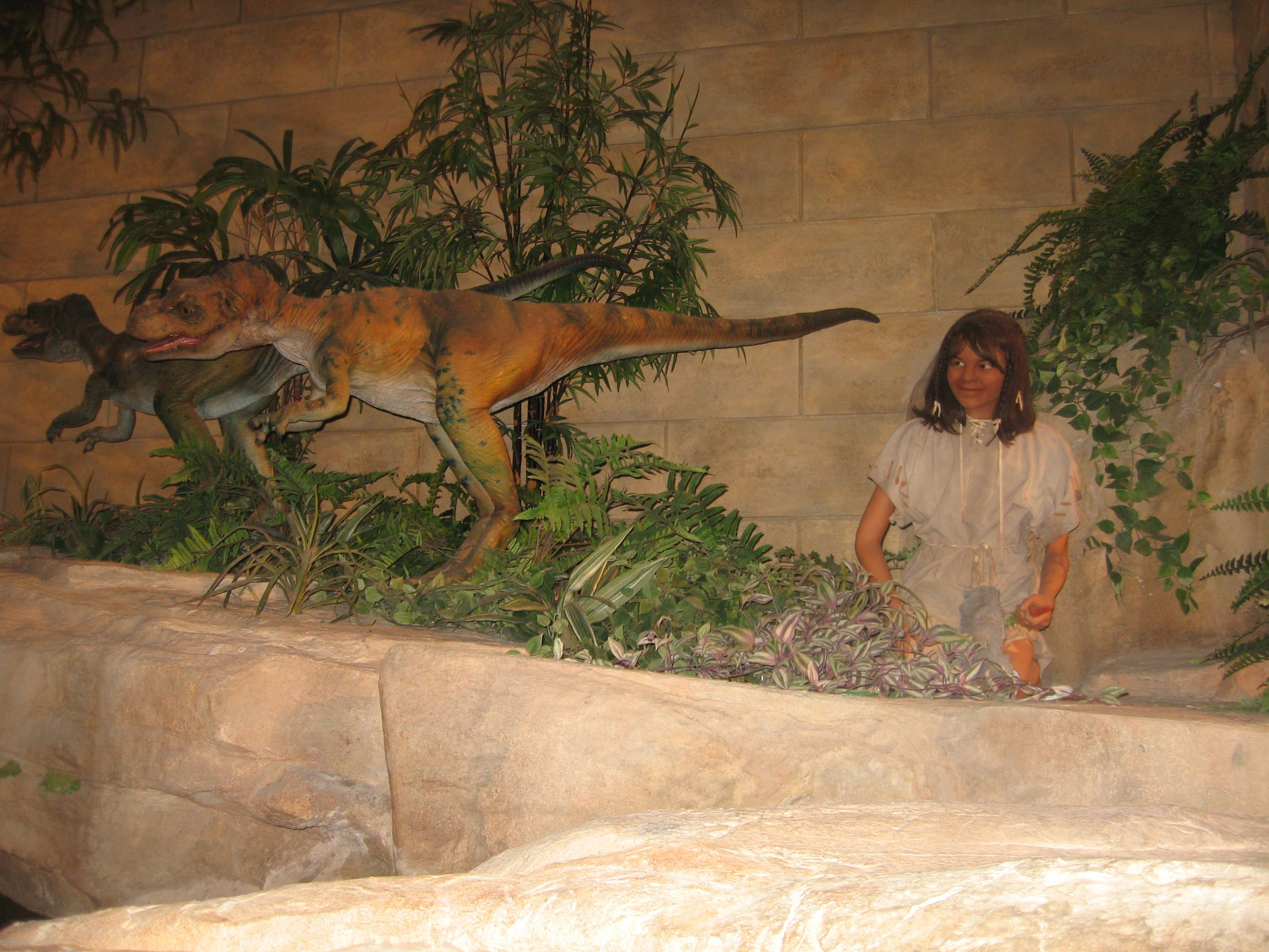 demon child plays with dinosaur at dawn of time 6000 years ago