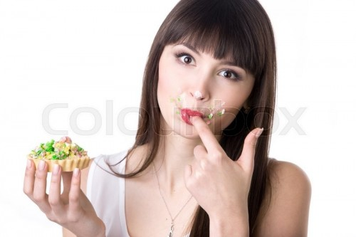17744418-woman-licking-her-fingers-while-eating-cake