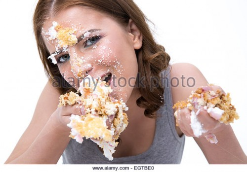 young-cute-woman-eating-cake-over-white-background-egtbe0